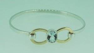 Two tone bangle with 2.28 carat Aquamarine