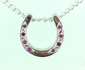 Horse shoe pendant with pink sapphires